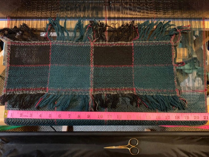Finished sample placed on top of original warp still on loom